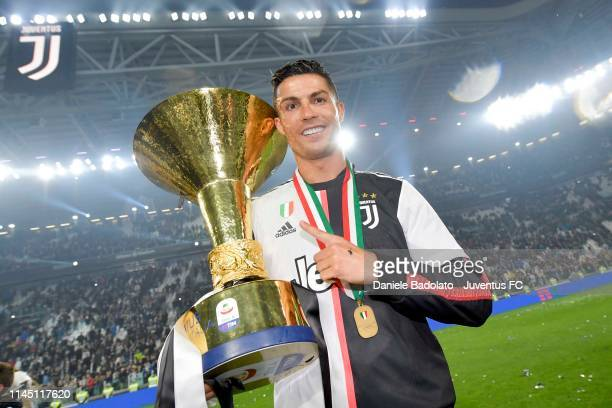 Cristiano Ronaldo of Juventus celebrates with the trophy after winning the Serie A Championship 20182019 at the end of the Serie A match between...