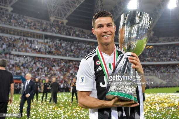 Cristiano Ronaldo of Juventus celebrates with trophy after winning the Italian Supercup match between Juventus and AC Milan at King Abdullah Sports...