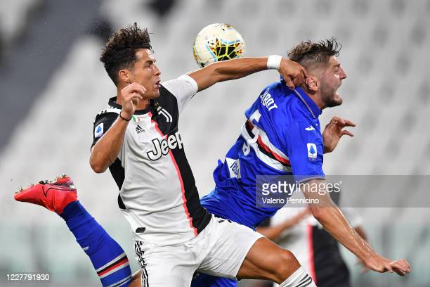 Cristiano Ronaldo of Juventus clashes with Julian Chabot of UC Sampdoria during the Serie A match between Juventus and UC Sampdoria at Allianz...
