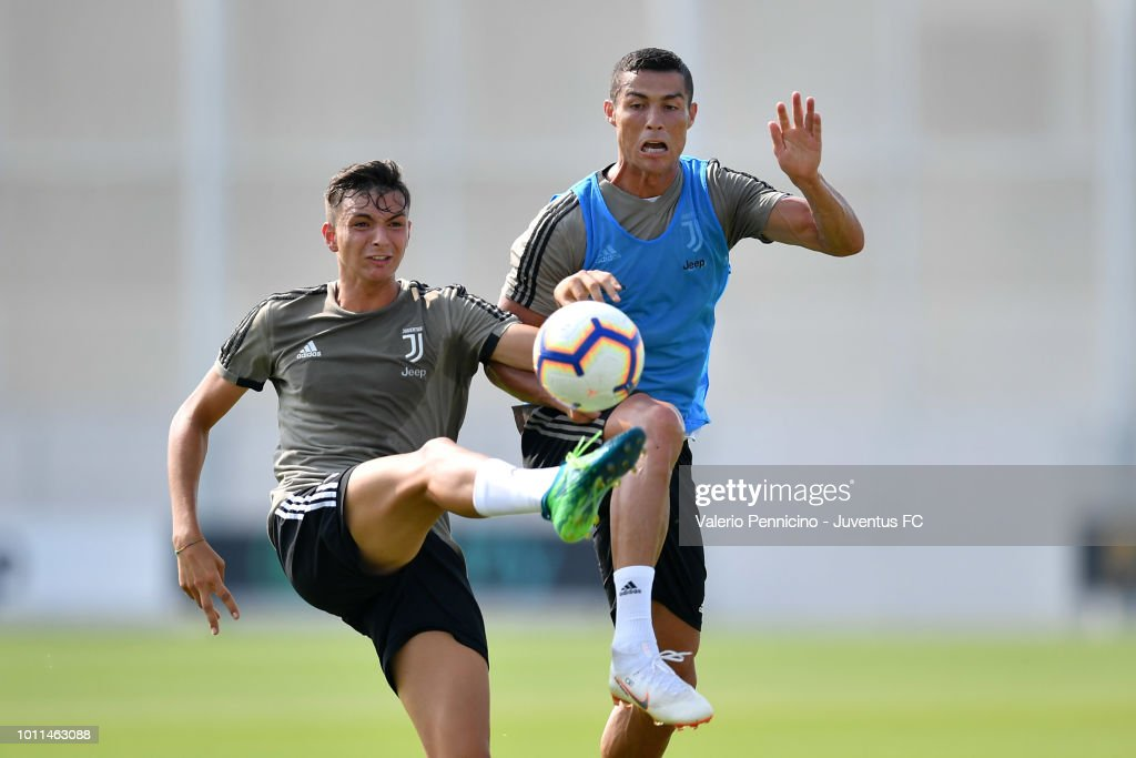 Cristiano Ronaldo (R) of Juventus competes during a training session at JTC on August 5, 2018 in Turin, Italy.