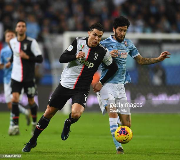 Cristiano Ronaldo of Juventus competes for the ball against Luis Alberto Romero Alconchel of SS Lazio during the Italian Supercup match between...