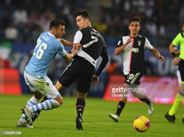 Cristiano Ronaldo of Juventus competes for the ball against Stefan Radu of SS Lazio during the Italian Supercup match between Juventus and SS Lazio...