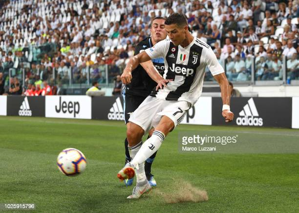 Cristiano Ronaldo of Juventus competes for the ball with Adam Marusic of SS Lazio during the Serie A match between Juventus and SS Lazio at Allianz...