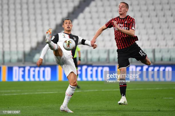 Cristiano Ronaldo of Juventus competes for the ball with Andrea Conti of AC Milan during the Coppa Italia SemiFinal Second Leg match between Juventus...