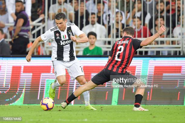 Cristiano Ronaldo of Juventus competes for the ball with Davide Calabria of AC Milan during the Italian Supercup match between Juventus and AC Milan...