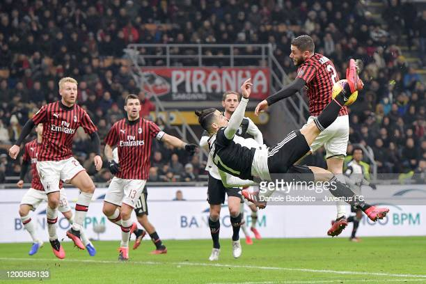 Cristiano Ronaldo of Juventus competes for the ball with Davide Calabria of AC Milan during the Coppa Italia Semi Final match between AC Milan and...