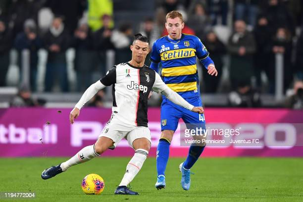 Cristiano Ronaldo of Juventus competes for the ball with Dejan Kulusevski of Parma Calcio during the Serie A match between Juventus and Parma Calcio...
