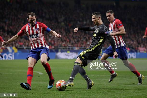 Cristiano Ronaldo of Juventus competes for the ball with Diego Godin of Atletico de Madrid during the UEFA Champions League Round of 16 First Leg...