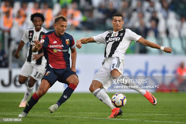 Cristiano Ronaldo of Juventus competes for the ball with Domenico Criscito of Genoa CFC during the Serie A match between Juventus and Genoa CFC at...