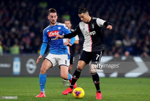 Cristiano Ronaldo of Juventus competes for the ball with Fabian Ruiz of SSC Napoli during the Serie A match between SSC Napoli and Juventus at Stadio...
