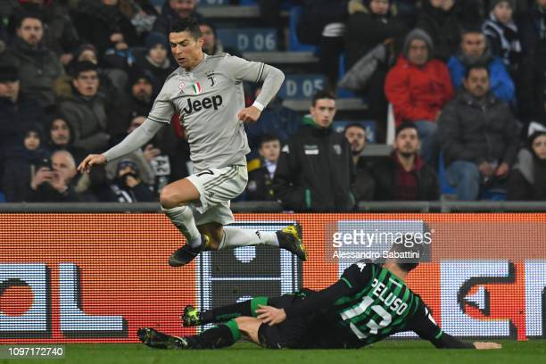 Cristiano Ronaldo of Juventus competes for the ball with Federico Peluso of Sassuolo during the Serie A match between US Sassuolo and Juventus at...