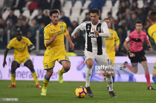 Cristiano Ronaldo of Juventus competes for the ball with Francesco Cassata of Frosinone during the Serie A match between Juventus and Frosinone...