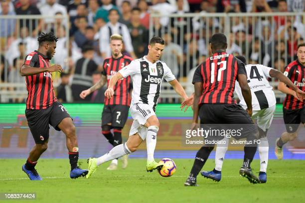 Cristiano Ronaldo of Juventus competes for the ball with Franck Kessié and Cristian Zapata of AC Milan during the Italian Supercup match between...