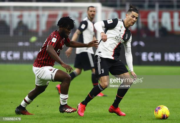 Cristiano Ronaldo of Juventus competes for the ball with Franck Kessie of AC Milan during the Coppa Italia Semi Final match between AC Milan and...