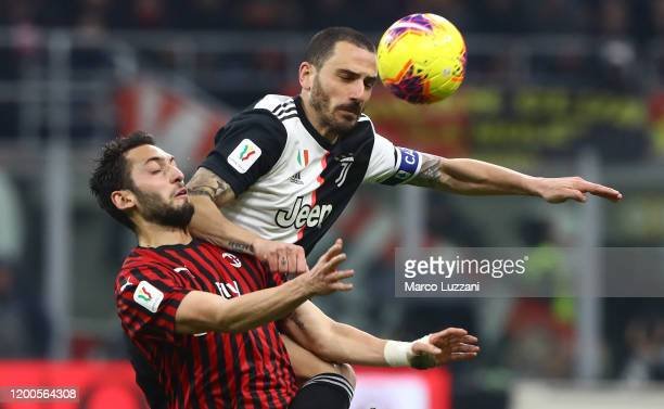 Cristiano Ronaldo of Juventus competes for the ball with Hakan Calhanoglu of AC Milan during the Coppa Italia Semi Final match between AC Milan and...