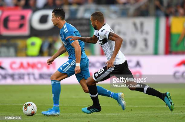 Cristiano Ronaldo of Juventus competes for the ball with Hernani of Parma Calcio during the Serie A match between Parma Calcio and Juventus at Stadio...