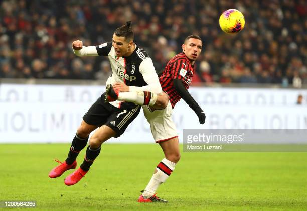 Cristiano Ronaldo of Juventus competes for the ball with Ismael Bennacer of AC Milan during the Coppa Italia Semi Final match between AC Milan and...