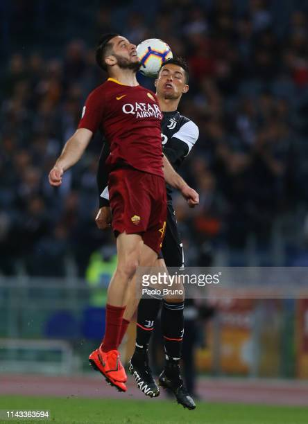 Cristiano Ronaldo of Juventus competes for the ball with Kostas Manolas of AS Roma during the Serie A match between AS Roma and Juventus at Stadio...
