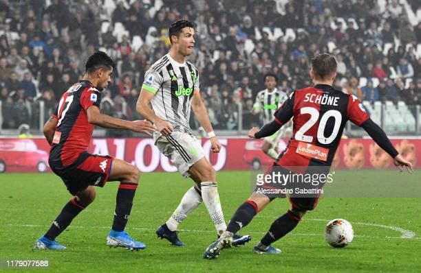 Cristiano Ronaldo of Juventus competes for the ball with Lasse Schone of Genoa CFC during the Serie A match between Juventus and Genoa CFC at on...