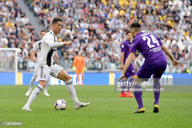 Cristiano Ronaldo of Juventus competes for the ball with Marco Benassi of ACF Fiorentina during the Serie A match between Juventus and ACF Fiorentina...