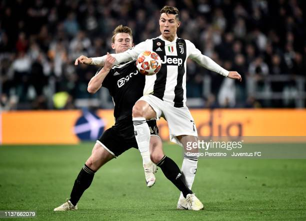 Cristiano Ronaldo of Juventus competes for the ball with Matthijs de Ligt of Ajax during the UEFA Champions League Quarter Final second leg match...
