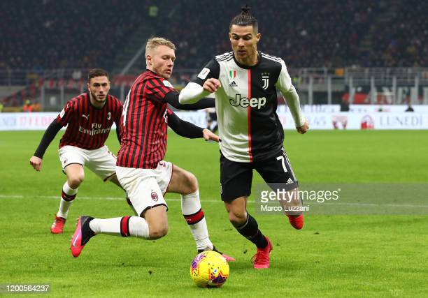 Cristiano Ronaldo of Juventus competes for the ball with Simon Kjaer of AC Milan during the Coppa Italia Semi Final match between AC Milan and...