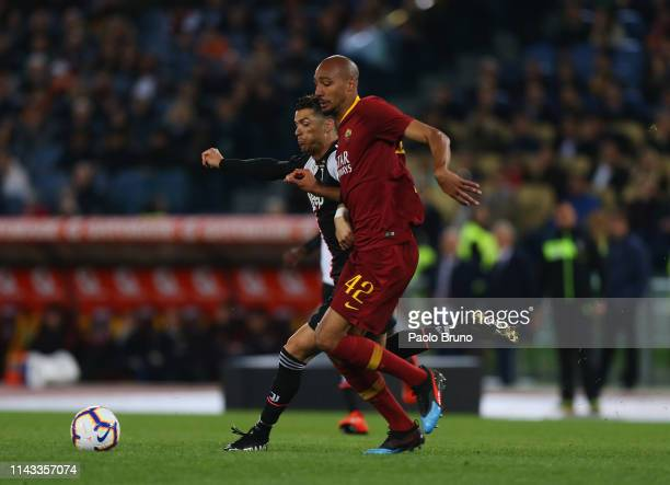 Cristiano Ronaldo of Juventus competes for the ball with Steven Nzonzi of AS Roma during the Serie A match between AS Roma and Juventus at Stadio...