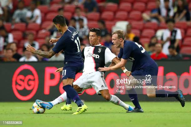 Cristiano Ronaldo of Juventus controls the ball against Erik Lamela and Oliver Skipp of Tottenham Hotspur during the International Champions Cup...