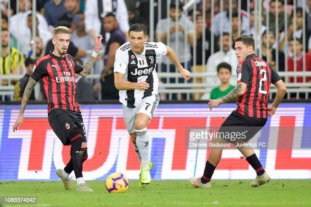 Cristiano Ronaldo of Juventus controls the ball during the Italian Supercup match between Juventus and AC Milan at King Abdullah Sports City on...