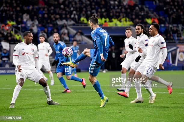 Cristiano Ronaldo of Juventus controls the ball during the UEFA Champions League round of 16 first leg match between Olympique Lyon and Juventus at...