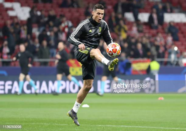 Cristiano Ronaldo of Juventus controls the ball during warm ups prior to the UEFA Champions League Round of 16 First Leg match between Club Atletico...