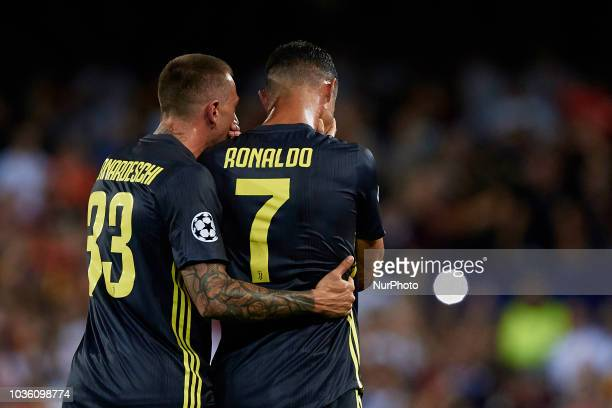 Cristiano Ronaldo of Juventus cries after taking a red card next to his teammate Federico Bernardeschi during the UEFA Champions League group H match...