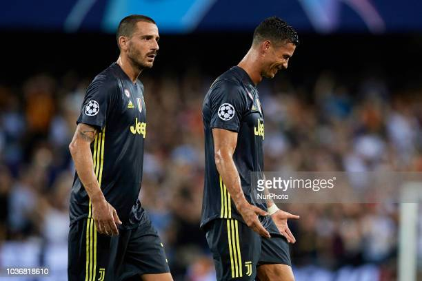 Cristiano Ronaldo of Juventus cries after taking a red card next to his teammate Leonardo Bonucci of Juventus during the UEFA Champions League group...