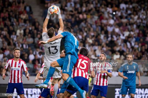 Cristiano Ronaldo of Juventus dives for the header but Jan Oblak of Atletico Madrid jumps and blocks the shot during the international Champions Cup...