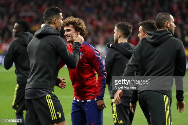 Cristiano Ronaldo of Juventus embraces Antoine Griezmann of Atletico Madrid prior to the UEFA Champions League Round of 16 First Leg match between...