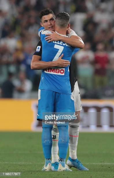 Cristiano Ronaldo of Juventus embraces Jose Callejon of SSC Napoli during the Serie A match between Juventus and SSC Napoli at Allianz Stadium on...