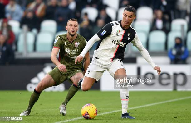 Cristiano Ronaldo of Juventus evades challenge from Sebastian Walukiewicz of Cagliari during the Serie A match between Juventus and Cagliari Calcio...