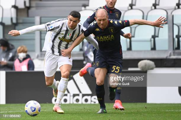 Cristiano Ronaldo of Juventus FC against Andrea Masiello of Genoa CFC during the Serie A match between Juventus and Genoa CFC at Allianz Stadium on...