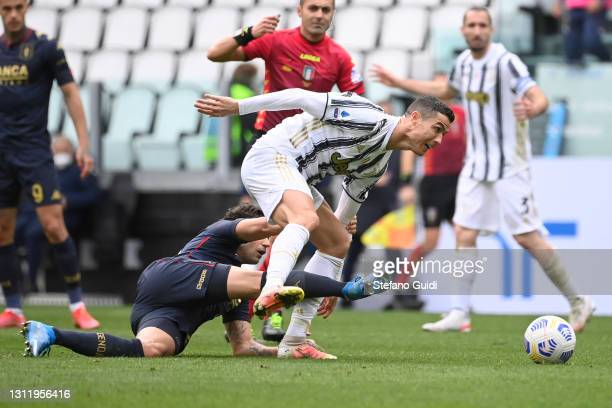 Cristiano Ronaldo of Juventus FC against Ivan Radovanovic of Genoa CFC during the Serie A match between Juventus and Genoa CFC at Allianz Stadium on...