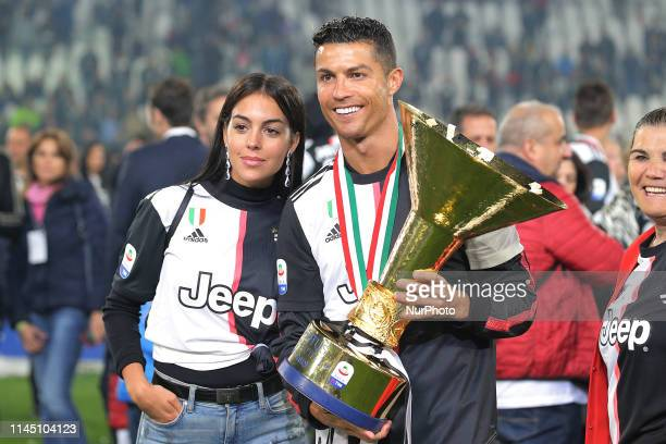 Cristiano Ronaldo of Juventus FC and Georgina Rodriguez celebrate with the trophy after winning the Serie A Championship at the end of the serie A...