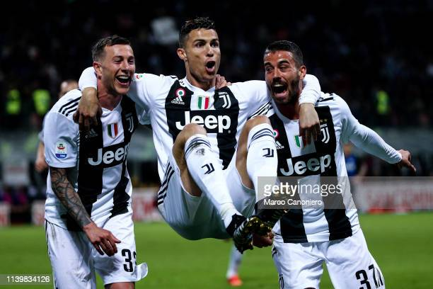 Cristiano Ronaldo of Juventus FC celebrate with his teammates Federico Bernardeschi and Leonardo Spinazzola after scoring a goal during the Serie A...