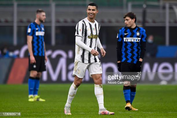Cristiano Ronaldo of Juventus FC celebrates after scoring a goal as Milan Skriniar and Nicolo Barella of FC Internazionale look dejected during the...