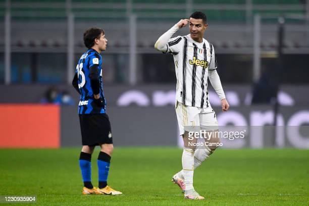Cristiano Ronaldo of Juventus FC celebrates after scoring a goal as Nicolo Barella of FC Internazionale looks dejected during the Coppa Italia...