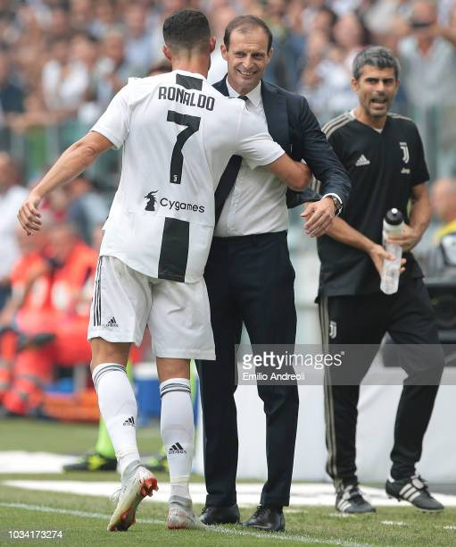 Cristiano Ronaldo of Juventus FC celebrates after scoring the opening goal with his coach Massimiliano Allegri during the serie A match between...