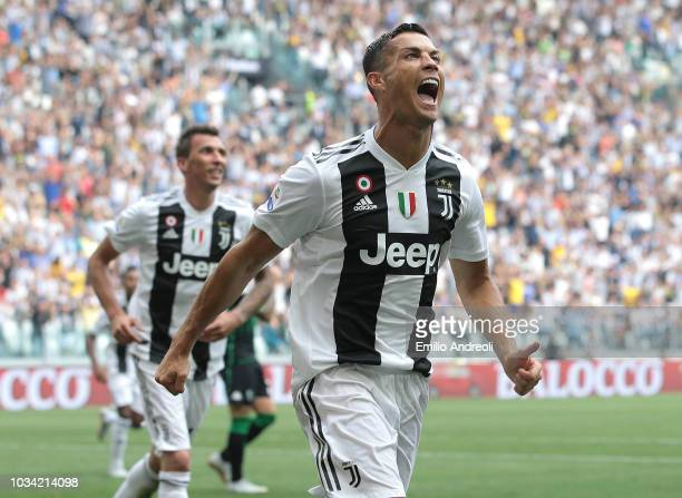 Cristiano Ronaldo of Juventus FC celebrates after scoring the opening goal during the serie A match between Juventus and US Sassuolo at Allianz...