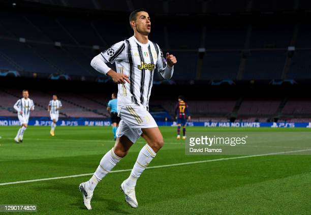 Cristiano Ronaldo of Juventus F.C. Celebrates after scoring their team's first goal from the penalty spot during the UEFA Champions League Group G...