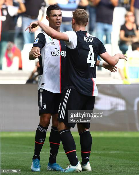 Cristiano Ronaldo of Juventus FC celebrates his goal with his team-mate Matthijs de Ligt during the Serie A match between Juventus and SPAL at...