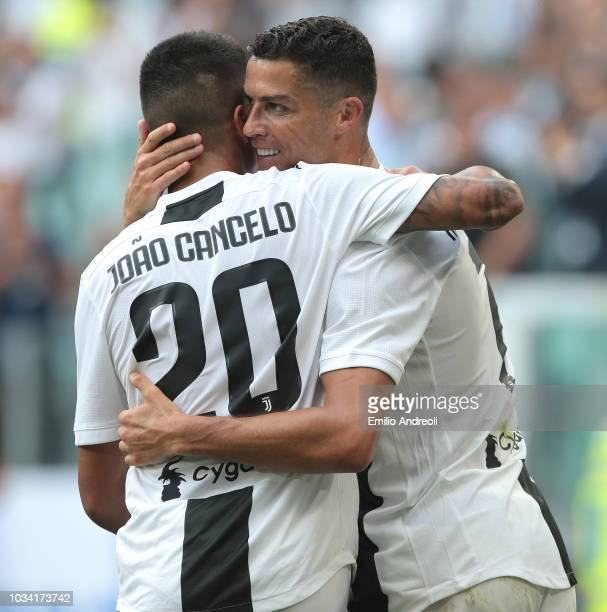 Cristiano Ronaldo of Juventus FC celebrates his second goal with his teammate Joao Cancelo during the serie A match between Juventus and US Sassuolo...