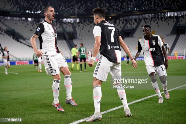 Cristiano Ronaldo of Juventus FC celebrates with Leonardo Bonucci and Blaise Matuidi of Juventus FC after scoring a goal from a penalty kick during...