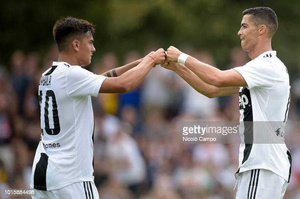Cristiano Ronaldo of Juventus FC celebrates with Paulo Dybala after scoring a goal during the preseason friendly match between Juventus FC and...